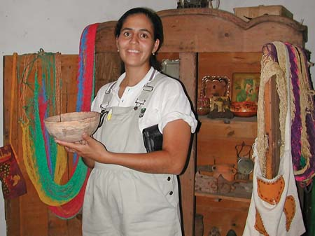 Proprietor showing Clay Bowl made in Lake Costa Rica