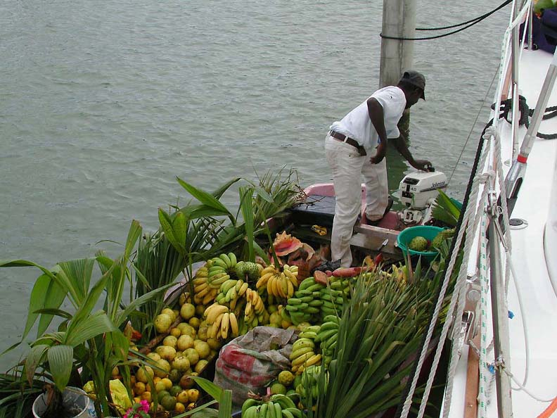 A man delivers fresh produce directly to our catana Pacific Bliss.