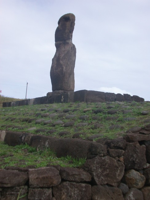 A Moai Stands Forlorn against a withering grey Sky
